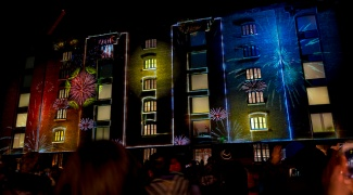 Fireworks projected on to building